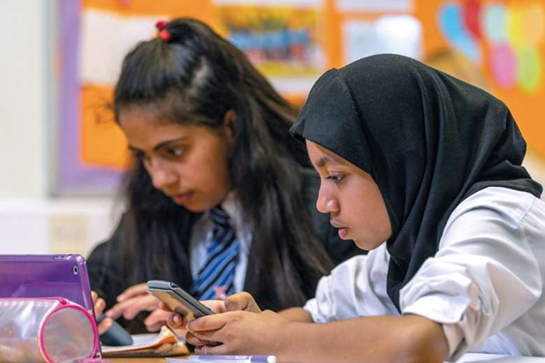 Digital devices in the classroom allow teachers at St James' School to tailor lessons to the needs of individual pupils, helping to identify those in need of extra support. Picture: Sparx
