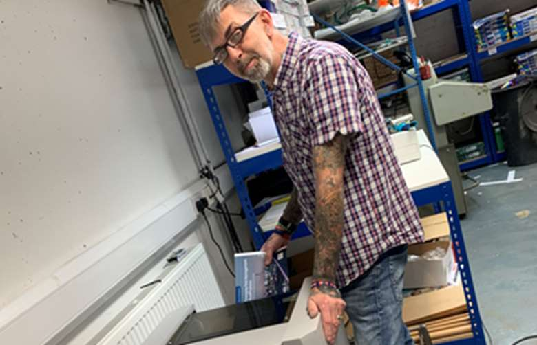 Simon Rumball with the new bookletmaker