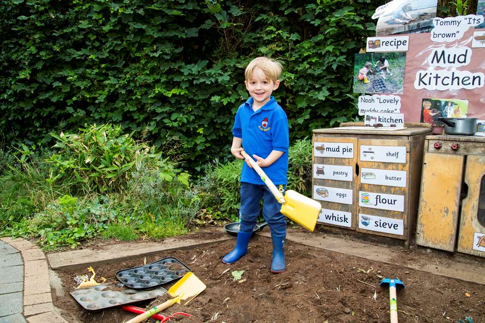 Children enjoy time spent in the mud kitchen at Busy Bees Hartham Park Nursery.