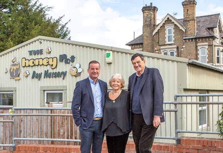 Children 1st managing director Adrian Mason with company founders Margaret Mason, and Hugh Mason, outside the group's latest acquisition