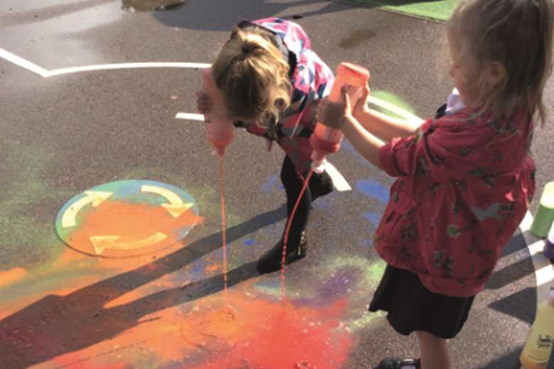 Experimenting with paint in the playground