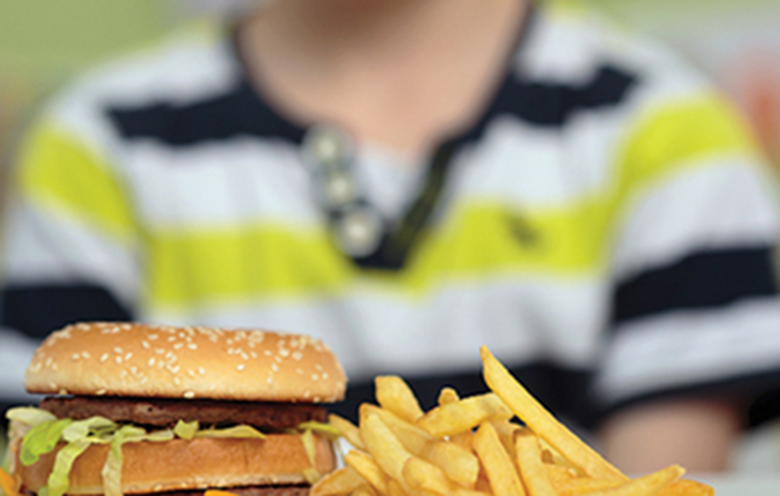 The report calls on government to consider banning the sale of fast food to children before 6pm on weekdays. Photo: Adobe Stock