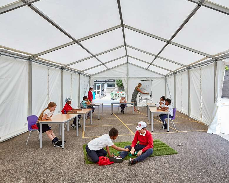 The pop-up tent provides a classroom and lunch area. Photo by Kilian O'Sullivan.