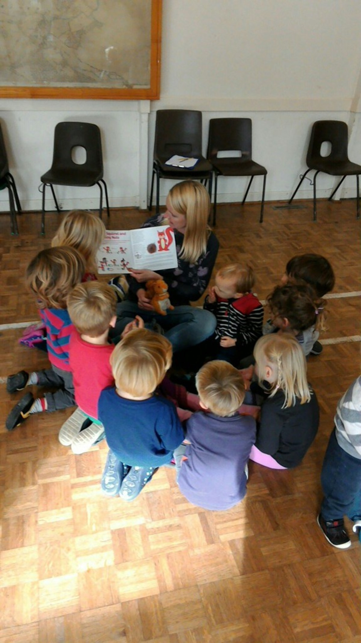 Debbie Giles reads Sammy Squirrel to her pre-schoolers.