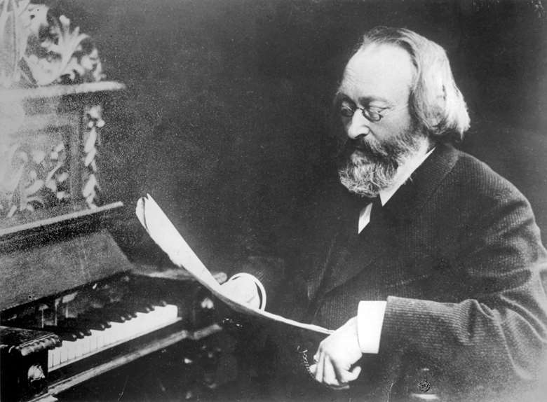 Bruch pictured working at the piano, an instrument he loathed, with its 'dull rattle-trap'; as he famously remarked, 'The violin can sing a melody better than the piano can' (AKG Images)