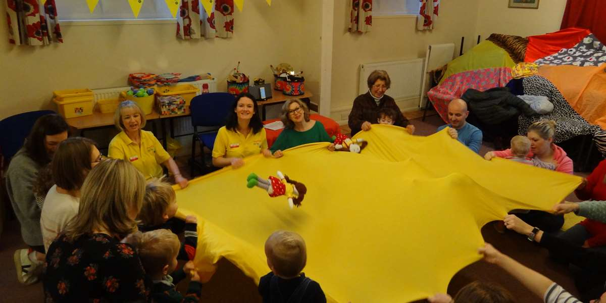 Early years-age children enjoying a song with Kathy Doolan (in green) and Warwickshire Rhythm Time franchisee Rachel Turner (in yellow)
