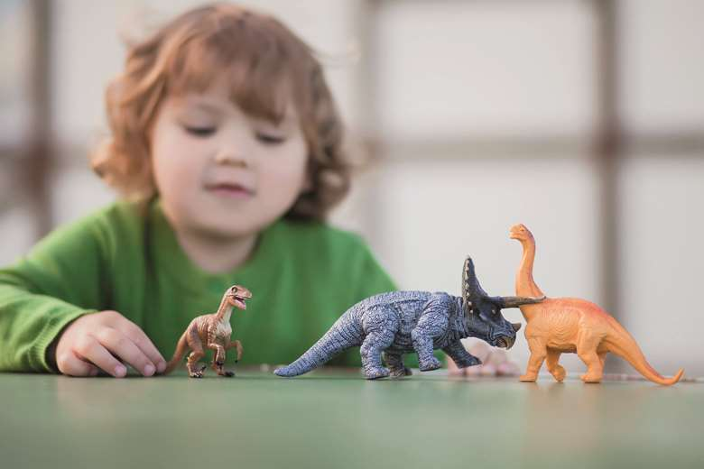 Dinosaurs and vehicles are classic small-world props