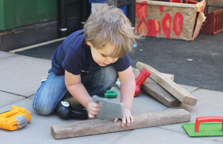 Children are free to use the well-equipped outdoor space at Sarratt Ducklings Pre-School