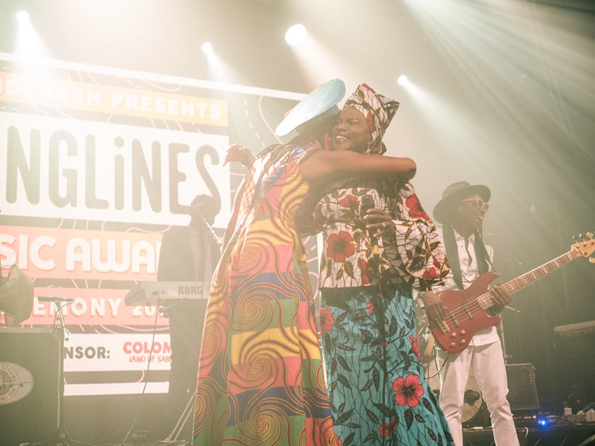 Fatoumata Diawara and Angélique Kidjo embrace at the end of the ceremony